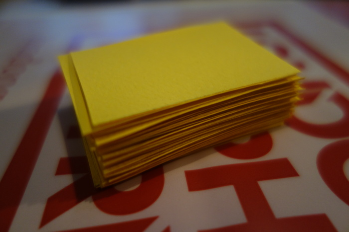 Stack of 1/32 cut yellow paper